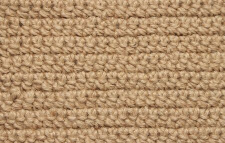 The texture of knitting from jute threads.