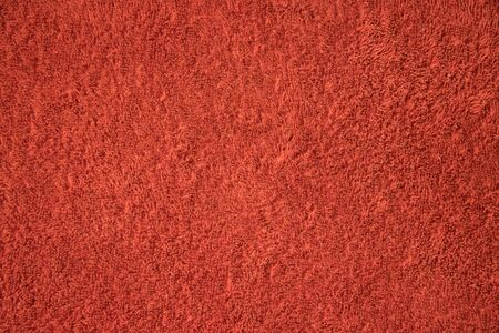 The texture of a terry red towel made of threads. Imagens