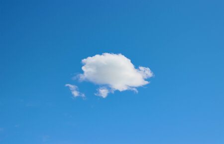Lonely cloud soaring in the blue sky.