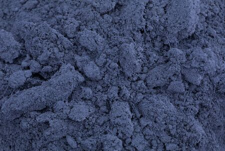 Abstract gray-blue background of bulk material. Imagens