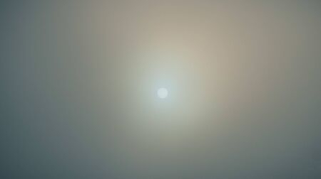 The sun in the morning in the foggy sky. Imagens