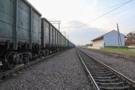 Rail freight transportation. Freight cars standing at the intermediate station.