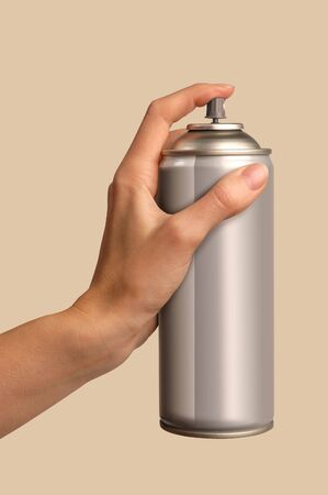 paint container: female hand spraying from a can