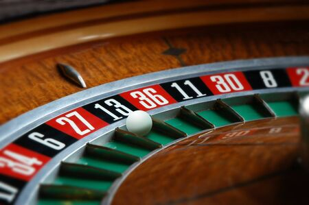 Roulette wheel with ball in thirteen slot