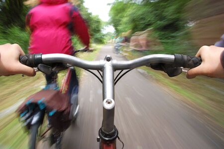 speeding along a cycle path on a bicycle