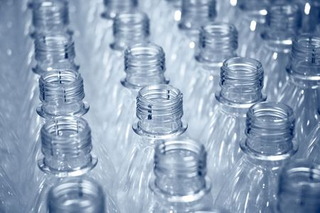 rows of plastic bottles on a factory production line                                 Stock Photo