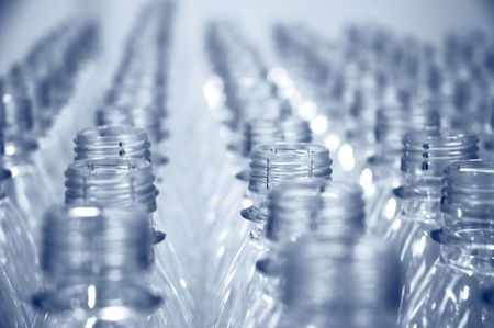 rows of empty  bottles at bottling plant