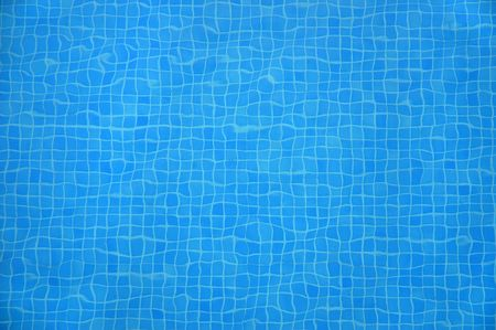 blue mosaic tiles at the bottom of a swimming pool