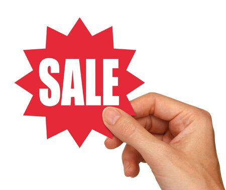 young female hand holding a red sale sticker                                 Stock Photo