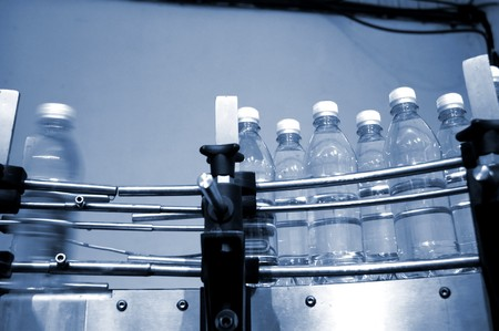 empty water bottles on factory conveyor belt