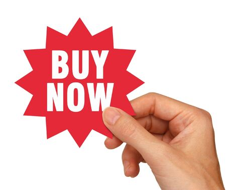 young female hand holding a red buy now sticker for use on internet shopping web pages. Isolated on white includes clipping path.