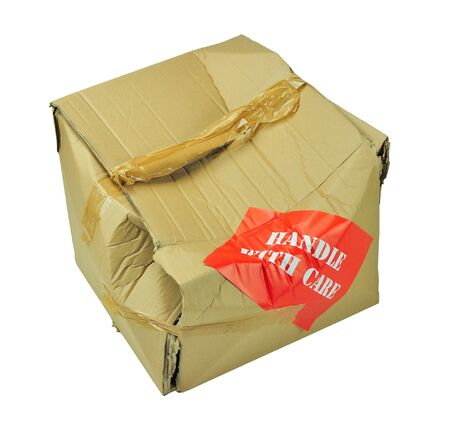 handle with care: cardboard box which has been damaged in transit