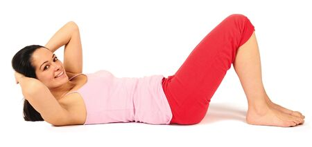 young woman doing stomach exercises on floor Stock Photo