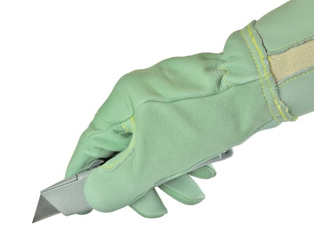 utility knife: hand wearing safety glove holding a utility knife