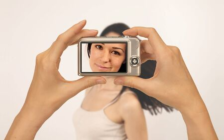 taking photograph of a beautiful girl with a compact digital camera