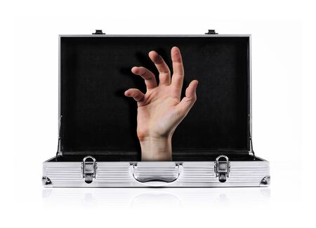 appearing: hand appearing from inside a metal briefcase
