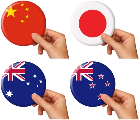 hand holding icons of flags of China, Japan, Australia and New Zealand.   photo