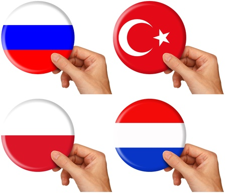 hand holding icons of flags of Russia, Turkey, Poland and the Netherlands.  photo