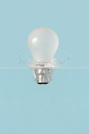light bulb dropping into water creating a splash photo