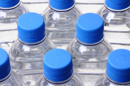 plastic container: looking down on a group of water bottle lids