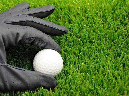 golf glove: close up of golf glove and golf ball Stock Photo