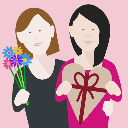 happy young lesbian couple in love exchanging gifts on saint valentines day