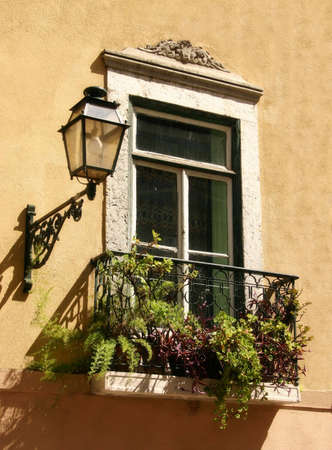 An old building: window and lamp photo