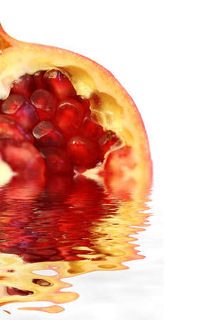 Pomegranate on water Stock Photo