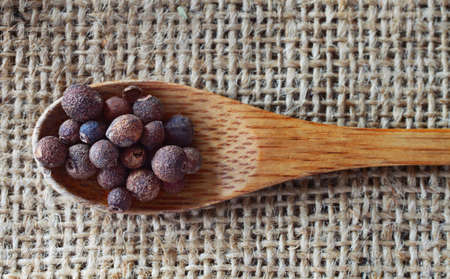 jamaican food: Allspice over rustic background