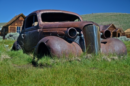 Old Car in Field photo