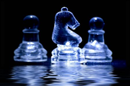 crystal chess pieces with reflection photo