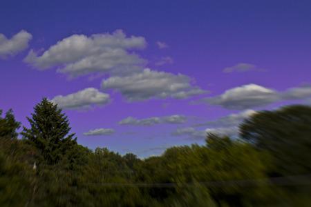 hued: Clouds over a purple hued sky Stock Photo