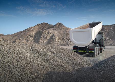 freightliner: Heavy truck offloading rocks