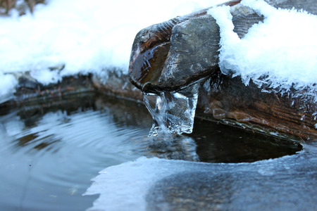 source: Water source in winter Stock Photo