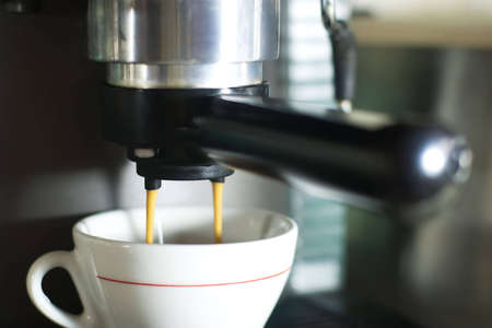 making coffee using espresso machine photo