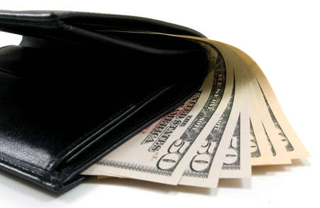 black leather wallet with american dollars isolated on white photo