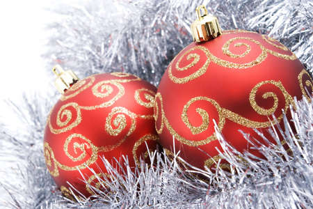 two christmas balls with tinsel isolated on white background photo