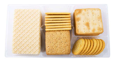 big pack of different crackers and cookies isolated on white background photo