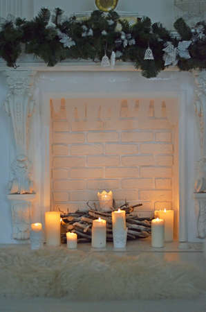 fire place: Isolated fire place with candles and fire Stock Photo