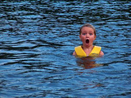 Girl swimming in cold lake
