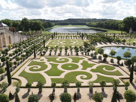 versailles: Decorative gardens with orange trees at Versailles in France