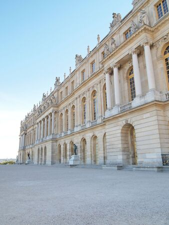 frontage: Castle of Versaille frontage with blue sky in the background