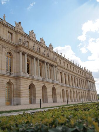 frontage: Castle of Versaille frontage with blue sky in the background , Landscape    Stock Photo