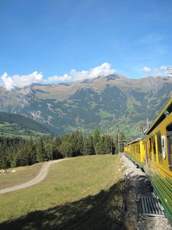 Cog-wheel train between jungfraujoch and  interlaken at Switzerland  Europe                     photo