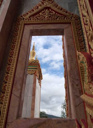 Look through window at Wat Chalong temple in Phuket Thailand photo
