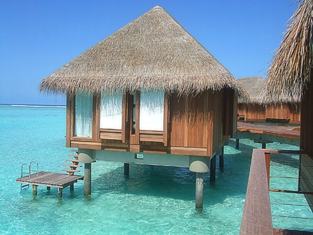 bungalows: Over water Bungalow and the turquoise sea at the Maldives with beautiful blue sea and sky