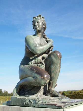 Beautiful Statue with blue sky at Versailles castle in France , Europe photo