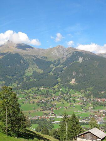 Swiss Culture with village at Jungefrau above Grindelwald, Switzerland  photo