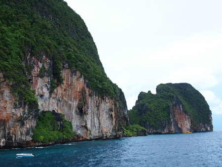 administratively: The Phi Phi Islands are located in Thailand , between the large island of Phuket and the western Andaman Sea coast of the mainland. The islands are administratively part of Krabi province in Thailand. (Horizontal) Stock Photo