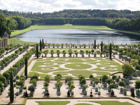 symetric: Decorative gardens with Orange trees at Versailles in France , Europe Stock Photo